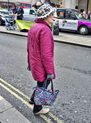 My Hat And Coat Dont Match (tcees) Tags: oxfordst london w1 sidewalk pavement man woman people building shops island hat coat bag taxi x100 fujifilm finepix streetphotography street oxfordcircus urban road traffic