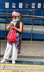 Style is a personal thing. (hksleeper) Tags: streetphotography googlepixel2xl smartography hongkong asia happy different style hip colourful mtr taiwai newterritories woman badminton blue flowers