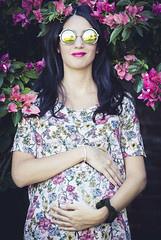 Flowers on flowers. (Pablin79) Tags: wavyhair beautifulpeople wearingflowers dress longhair sleevelessdress happiness portrait woman girl outdoors pregnant flowers colors shadows posadas misiones argentina light sunglasses smile afternoon