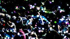 Summer in the City, Edinburgh  [02] (that petrol emotion) Tags: img3710 themound princesstreet bubbles entertainment edinburgh scotland tourist light sunlight bokeh blur