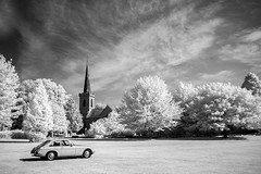 mgb on the lawn ir (photoautomotive) Tags: stanmer brighton eastsussex england europe uk park infrared ir irconverted car mgb church tree trees grass building blackandwhite monochrome english sky clouds shadows canon350d sigma1020