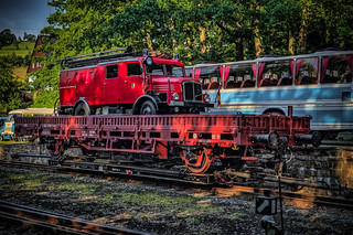 a classic fire truck on a railway flatcar