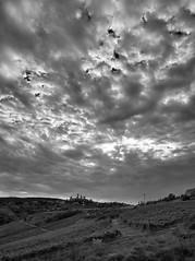 Cloud cover (hbothmann) Tags: sangimignano schwarzweis loxia2821 zeiss toskana toscana tuscany blackandwhite blackwhite bianconero wolken wolkendecke clouds cloudcover italien hendrickbothmann