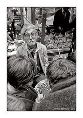 Nottingham Goose Fayre (Peter Dewhurst) Tags: fayre fair goose nottingham goosefair goosefayre jumpingbeans man glasses fag cigarette butt stall tray kids film trix d76 nikonf2 analogue 1975 2for10p