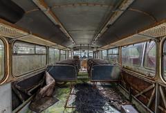 La meilleure place est au fond (Jacadit, L'empreinte du temps) Tags: bus decay decaying abandon abandoned abandonné old past france midi pyrennees occitanie lines perspective