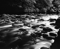 img125 (Adam Clark Photography) Tags: blackandwhite black white river rocks water tones stopper bigstopper ilford fp4 caffenol longexposure analog analogue film shootfilm 120mm 100mm bronica development medium format
