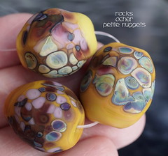 Rocks Ocher Petite Nuggets (Laura Blanck Openstudio) Tags: openstudio openstudiobeads glass handmade lampwork murano fine art arts artist artisan beads set opaque matte frosted etched glow glowing rocks nuggets pebbles stones whimsical funky odd abstract asymmetric speckles frit raku yellow ocher maize suede honey caramel coral mauve pink fuchsia lilac lavender aqua green colorful multicolor