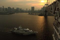 Gateway to Tokyo (seiji2012) Tags: 東京 東京湾 レインボーブリッジ 客船 夕日 夕陽 tokyo rainbowbridge boat sunset reflection
