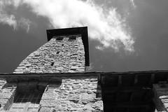 Fort Libéria, la tour en contre plongée (vieux rêveur) Tags: noiretblanc nb bw bn noir black negro blanc blanco white pierre rock castle fort sky ciel ancien old tour tower