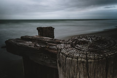 Weathered/7 (trevormarron) Tags: wood long exposure longexposure grain texture worn desolate tattered weathered landscape beach waves ocean overcast