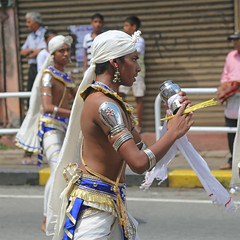 Perahera Dancer (1X7A4758b) (Dennis Candy) Tags: srilanka ceylon serendip kandy esala day perahera street procession parade pageant festival religion buddhism tradition culture heritage costume dancer boy youth offering water rice white blue