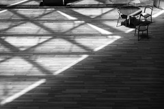 a study in shapes / lonely as a table (Özgür Gürgey) Tags: 2018 50mm atatürkairport bw d750 nikon architecture chair diagonal lines parquet shapes table triangles istanbul