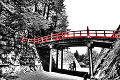 The Red Bridge (B&W selective: Red) (David K. Werk) Tags: bridge red black white railing asia asian japanese bike person travel walk old ancient historic selective color morioka castle iwate japan bw under over biking shade shadow day sky light silhouette figure contrast high road roadway walkway tree forest wall