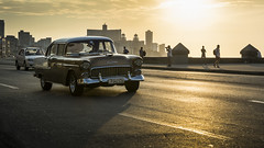 Chevy on the Malecon (kuhnmi) Tags: chevrolet car classiccar oldtimer auto automobil pkw taxi cab malecon street road sunset sonnenuntergang eveningsun abendsonne habana havanna havana kuba cuba driving drive fahren autofahrt strasse cityscape stadt city town