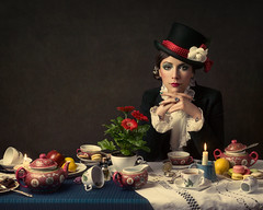 Alone in Wonderland (Giulia Valente) Tags: portrait portraiture woman beauty beautiful alone cinematic cinema movie story romance romantic one looking light shadow dark beam darkness mood moody atmosphere low key dream inspiring mad hatter alice wonderland cups tea party flowers