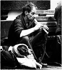 Life below the line (Neil. Moralee) Tags: neilmoralee man dog homeless rough sleeping begging busker tramp penniless broke music recorder harsh contrast teignmouth devon uk statistics poverty pity tired worout exhausted drug drugged drugs black white bw bandw blackandwhite mono neil moralee nikon d7200 noir comentarty social whistle flute woodwind instrumwnt unshaven dirty dark depressed depression desperate despair unemployed sad life people ruins deserted