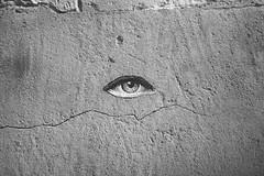 a tale for us (Alexandre Dulaunoy) Tags: sooc bw noiretblanc noirblanc mur oeil eye streetart street arles blackwhite stencil monochrome wall