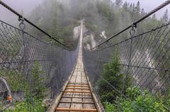 Suspension Bridge (ivanstevensphotography) Tags: bridge footbridge suspension wood height trees clouds