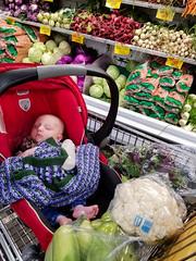 Dozing at Berkeley Bowl (quinn.anya) Tags: eliza baby carseat berkeleybowl vegetables produce
