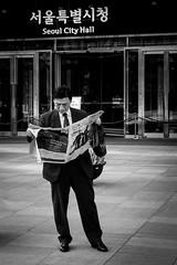 Seoul News (alexhaeusler) Tags: news blackwhite street people headlines korea