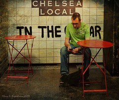 Chelsea Local (augenbrauns) Tags: enlightapp distressedfx olympusomdem1ii sitting iphone lookingatiphone redtables red oneperson painterly nyc chelseamarket