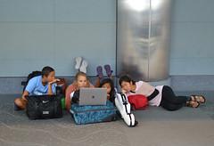 Hallway theater (radargeek) Tags: den denver airport travel colorado travelers traveler kid kids children laptop teenager sandals