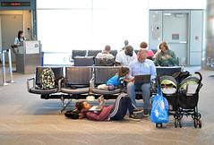 Screen time between flights (radargeek) Tags: den denver airport travel colorado travelers traveler kid kids children stroller laptop