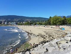 Ambleside Beach (walneylad) Tags: ambleside amblesidebeach amblesidepark westvancouver britishcolumbia canada july summer afternoon bluesky hot urban sand rocks water sea ocean pacificocean burrardinlet englishbay surf tide whitecaps trees park urbanpark parkland recreation weekend blue green golden white buildings people beachgoers children playing fun sun sunny day view scenery nature