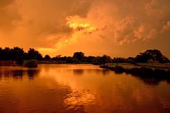 Orange Finale (NaturalLight) Tags: orange sunset reflections thunderstorm chisholmcreekpark wichita kansas