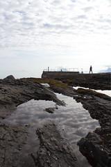 Anna på moloen -|- Anna on the pier (erlingsi) Tags: pier molo goksøyr runde noreg fjære fjærespeil reflection skycloud