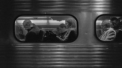 Metra Train (Jovan Jimenez) Tags: canon eos rebel t2 ef 40mm stm f28 kodak tmax 3200 transportation monochromatic metra train metro people black white gray film p3200 grain lines window analog analogue bw 300x kiss7 slr plustek opticfilm 8200i streetphotography