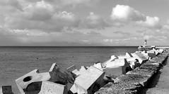 Dolosse... (Michele's POV) Tags: seaharbour wavebreakers wavedefense concretepuzzle protection geometric breakwater