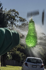 The Holy Avacado... (Mr Clicker / Davin) Tags: mrclicker davin water balloon bomb pop burst green spray