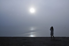 Catching the void (jeangrgoire_marin) Tags: normandy omahabeach fog mist foggy misty white calm zen minimalist lady gazing sun sea water