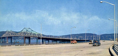 The brand new one year old Tappan Zee Bridge as shown in a vintage postcard portraying the marvels of modern engineering. What's amazing is that just a mere scattering of cars is crossing. No traffic jams. No divider, either! June 1957. New York State (wavz13) Tags: oldbridges vintagebridges newbridges highways freeways hudsonvalley hudsonriver westchestercounty rocklandcounty newyorkthruway newyorkthroughway newyorkstatethruway newyorkphoto newyorkphotography highwayphotography bridgephotography newyorkphotos highwayphotos bridgephotos construction constructionsites bridgeconstruction newyorkbridges hudsonriverbridges cars infrastructure newyorkhighways traffic vintagepostcards oldpostcards 1950spostcards collectablepostcards collectiblepostcards vintagephotographs vintagephotos oldphotographs oldphotos vintagephotography filmphotos filmphotography newyorkphotographs oldnewyorkphotography oldnewyorkphotos vintagenewyork oldcar vintagecar 1950scar collectiblecar collectablecar antiquecars 1950scars oldcars vintagecars collectiblecars collectablecars