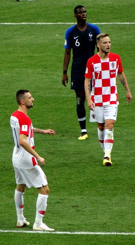 Marcelo Brozovic and Ivan Rakitic of Croatia in midfield with France's Paul Pogba behind in the 2018 World Cup Final
