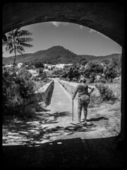 Below a bridge. . . (CWhatPhotos) Tags: cwhatphotos bw black white mono woman standing below milf bridge back landscape view photographs photograph pics pictures pic picture image images foto fotos photography artistic that have which contain olympus camera holiday holidays hols hol june 2018 ibizan ibiza santaeulariadesriu santa eularia east eastern