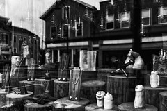 What Are You Looking At (joegeraci364) Tags: black white art store front window shop statue building road reflection town display jewelry face abstract