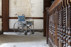 W State Hospital (Jonnie Lynn Lace) Tags: abandoned abandonedamerica abandonedhospital heels peelingpaint paintchips texture blue red white black light dark shadows sunlight nautrallight decay decayed decaying ruins modernruins ma abandonedma interior indoor indoors old rust rusty nikon nikkor december contrast day urbex textures bright america asylum american wheelchair chair details detail inside classic usa unitedstates hospital statehospital insane institution 50mm digital perspective depth dof wood woodwork exploration explore explorer