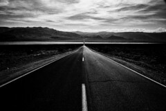 The Endless Road (Harald Philipp) Tags: outdoors rural panorama sand landscape clouds sky desert dry outback natural scenic mountains hill road heat hot holiday vacation tourism tourist exotic destination travel adventure beautiful romantic mysterious death nikon nikkor d810 light sun vanishingpoint daytime panamint panaminthighway panamintsprings nadeautrail deathvalley unitedstates deserted california usa park nationalpark monochrome bw blackandwhite nocolor dead nothing endless horizon