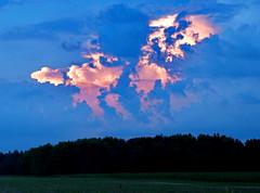 The Other Side of Sunset (nelhiebelv) Tags: postsunset brightlylit shrouded light cloud clintoncounty cloudsstormssunsetsandsunrises