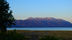 After Sunset on Utah Lake (Jim Mullhaupt) Tags: sunset sundown dusk sun evening endofday sky clouds color red gold orange pink yellow blue tree outdoor silhouette weather wallpaper landscape nikon coolpix p900 pond lake water reflection jimmullhaupt cloudsstormssunsetssunrises utahlake utah mountains mttimpanogos wasatchrange boating tubing hunting summer birds ducks geese carp recreation fun vacation scenery kids party boats saratogasprings lehi provo americanfork saltlakecity nikoncoolpixp900 nikonp900 coolpixp900 photo flickr geographic picture pictures camera snapshot photography phragmites