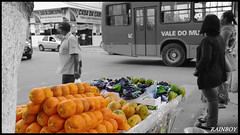 """Selling colors in the middle of black and white ..."" (Guilherme Alex) Tags: life seller bus cars city cityscape citylife citycenter cityday citymarket fruits colorfull blackandwhite cutout car wheels run fast rushhour street myworld mycity mylife walking exploring world teófilootoni minasgerais brazil brasil samsung dv100 digitalcamera shot amateur urban urbanization citizen people angle composition cityview"