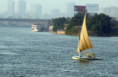 A Boat Ride (Khaled M. K. HEGAZY) Tags: nikon coolpix p520 nilesmart cairo egypt nature outdoor closeup nile river water boat sail tree bridge buildings cars green yellow blue brown white