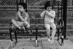 Waiting... (Livia Lopez) Tags: blackandwhite blancoynegro noiretblanc kids busstop monochrome canon canon700d photography street fotografia calle niños city siblings brother sister biancoenero canont5i bench