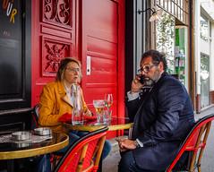 PrimeTourist.jpg (Klaus Ressmann) Tags: klaus ressmann omd em1 fparis france peoplestreet spring cafe candid couple flcpeop phone streetphotography tourist unposed klausressmann omdem1