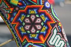 wheel huichol detail (ikarusmedia) Tags: detail zoom closeup huichol art artcraft sculpture peyote beads chaquira mexico city reforma expo texture pattern