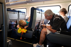 Playin' with Grandpa (dangaken) Tags: chicago chicagoil il illinois windycity cityofbroadshoulders fuji fujixt2 xt2 fujifilmxt2 photobydangaken dangaken summer 2018 summer2018 travelbytrain vacation train rail railroad railway fromthetrain amtk amtrak nschicagoline grandpa grandparents trainride amtrakhorizonfleet coach amtrakcoach horizonfleetcoach grandchild people