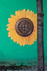 You are a Sunflower! (Leaning Ladder) Tags: tirana albania streetart murals graffiti sunflower flowers signs green yellow colors canon 7dmkii leaningladder