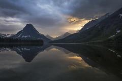 Ya.kiⱡ Haqwiⱡnamki (Ramen Saha) Tags: twomedicinelake glaciernationalpark nationalpark lake water reflection reflections montana sinopahmountain risingwolfmountain sunset stormyday ramensaha yakiⱡhaqwiⱡnamki